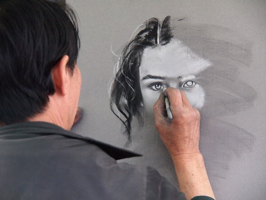 Man drawing woman's face