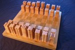 ../images/Wooden-chess-set-150.jpg